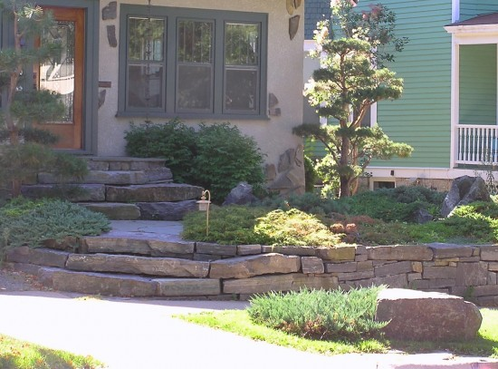This boulder adds to the garden's chores, but contributes mightily to its Asian-inspired design.