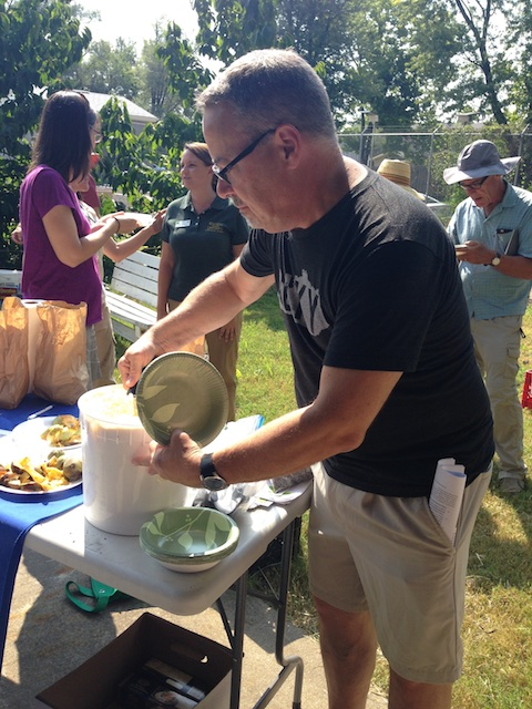 Dan Busch samples pawpaw ice cream. Sheri Crabtree is in the background.  Therese Busch photo.