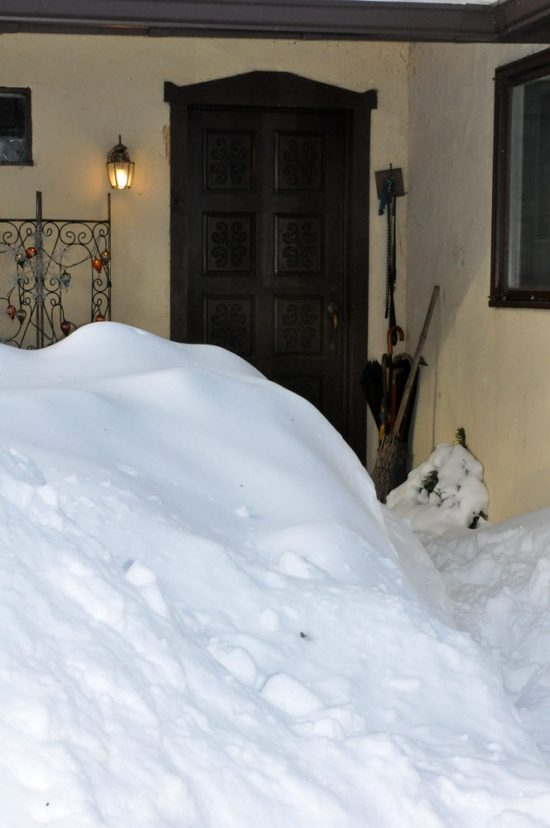 snow drift by door